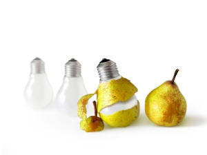 Concept for new idea, a peeled pear reveals a light bulb