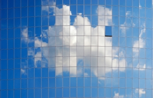 cloud reflection in a modern glass building - illusion