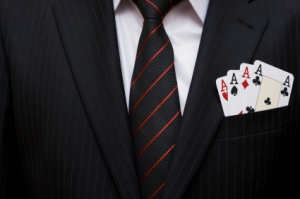four aces peeking from a business man's front suit pocket