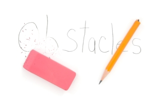 "pink eraser and word ""obstacles"" on paper"