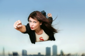 A modern superwoman in flight, probably a business woman