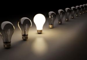 one lightbulb is lit among many- indicating a good idea