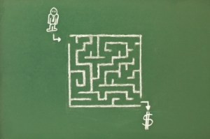 drawing of a maze with a customer at one end and money at the other concept of a sales funnel