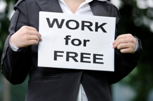 "woman with sign that reads ""work for free"""