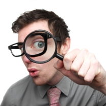 geek with magnifying glass