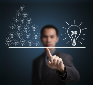 a big idea (lightbulb) is balanced by many smaller ideas (lightbulbs)