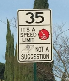 funny traffic sign in hayward california; message that gets attention in effort to change human behavior.